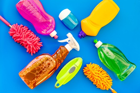 Housekeeping tool. Detergents, soap, cleaners and brush for housecleaner work on blue background top view space for text Stockfoto