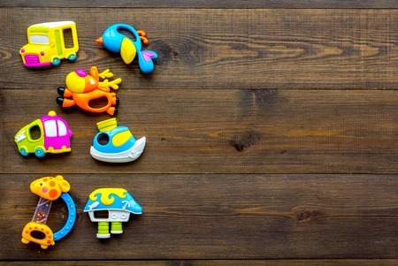 Craft toys for kids. Developing rattle for the smallest. Wooden background top view mock up Foto de archivo - 113826673