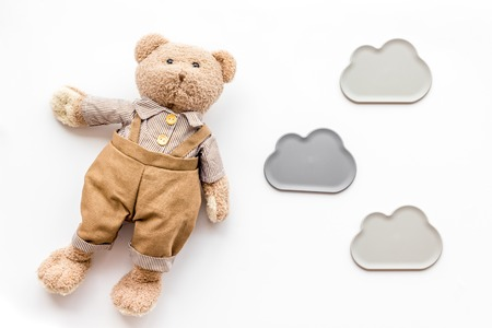Baby care with craft toys for newborn. Teddy bear. White background top view Stockfoto