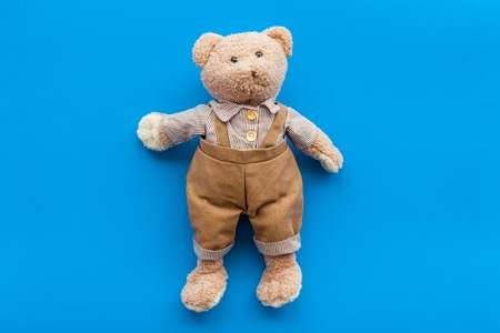 Craft toys for kids. Handmade teddy bear. Blue background top view Stock Photo