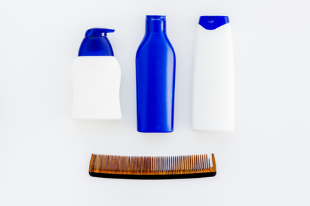 Male care set for barbershop with shampoo bottle and comb on white background top view mock-up