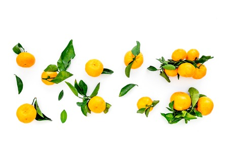 New Year and Christmas Eve with mandarins. Citrus winter fruits on white background top view