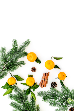 Branch of mandarins, fir tree and cinnamon for New Year and Christmas celebration on white background top view mockup
