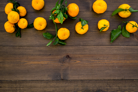 branch of mandarins for New Year and Christmas celebration on wooden background top view mockup Stock Photo