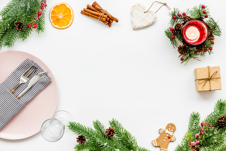Christmas and new year celebration with gift and fir tree on white table background top view mock up Foto de archivo