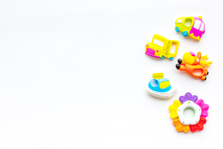 Handmade toys for newborn baby. Rattle. White background top view mockup Foto de archivo - 114196869