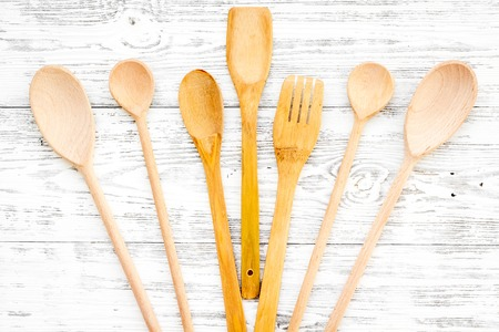 Village table with wooden cutlery set rustic background top view Stock Photo