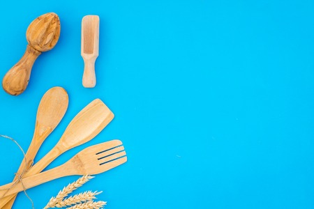 Village wooden cutlery set blue table background top view mockup
