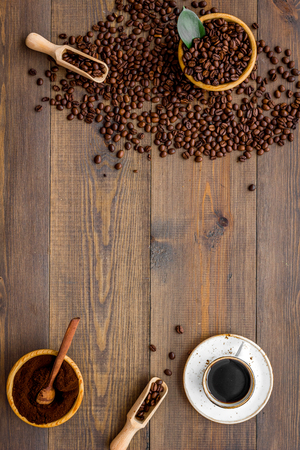 coffee background with beans and cup of americano wooden table flat lay space for text Zdjęcie Seryjne