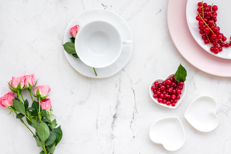 Colorful plate with flower and wineberry for table setting on stone table backgroung top view Stockfoto