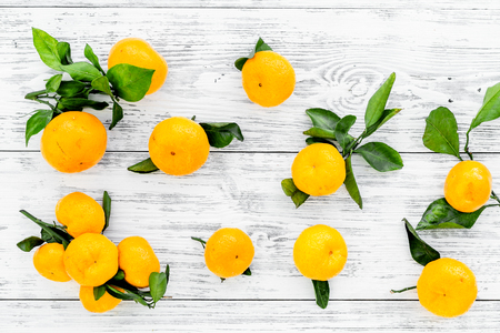 branch of mandarins for New Year and Christmas celebration on white wooden background top view Stock Photo