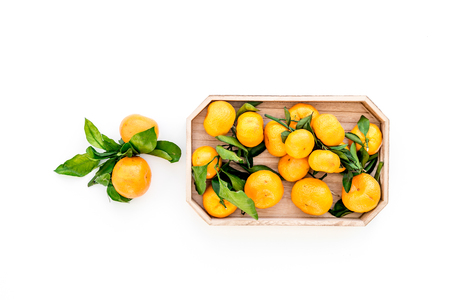 Pile of tangerines for New Year and Christmas celebration on white background top view