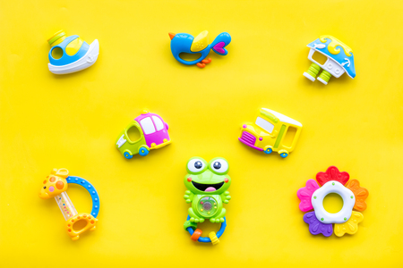 Craft toys for kids. Developing rattle for the smallest. Yellow background top view Foto de archivo - 114049842