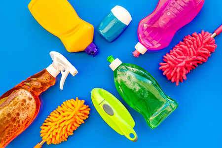 Housecleaning with detergents, soap, cleaners and brush in plastic bottles on blue background top view mockup Stockfoto