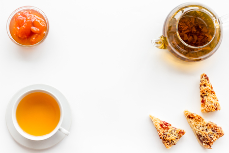 Tea with homemade cookies. Fresh cookies, cup of tea, teapot on white background top view space for text 스톡 콘텐츠