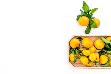 Winter fruits for New Year and Christmas. Tangerines on white background top view mock-up Stock Photo