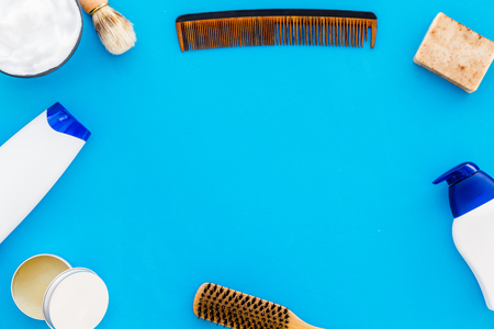 Barber workspace with equipment. Shampoo bottle and comb on light blue background top view space for text 스톡 콘텐츠