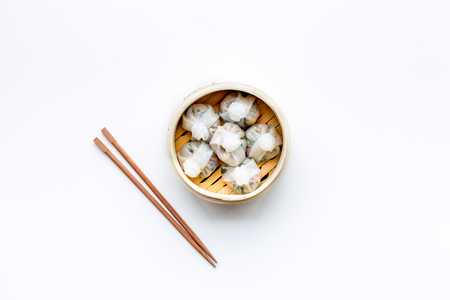 Chinese food set with dim sum, sticks on white background top view copy space Stock Photo - 114133642