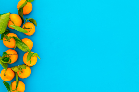 Pile of tangerines for New Year and Christmas celebration on blue background top view mock up Stock Photo