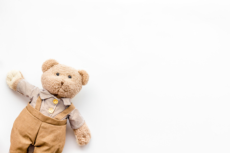 Handmade toys for newborn baby. Teddy bear. White background top view mockup