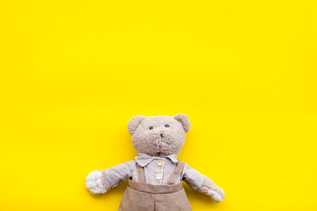 Craft toys for kids. Handmade teddy bear. Yellow background top view mock up Stockfoto