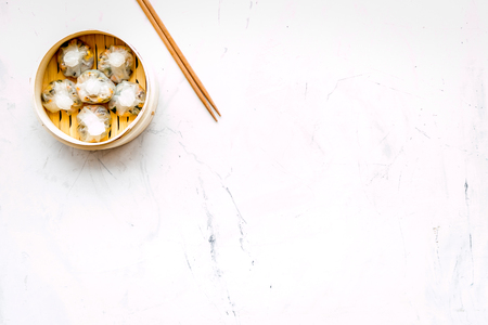 Chinese food set with dim sum, sticks on marble desk background top view copy space