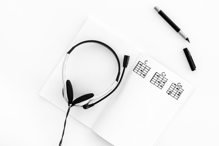 Desk of musician for songwriter work with headphones and notes white background top view mockup Stock Photo