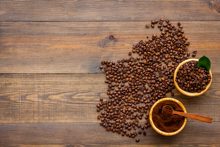 coffee background with beans and powder wooden table flat lay space for text