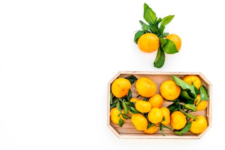 New Year and Christmas Eve with mandarins. Citrus winter fruits on white background top view space for text