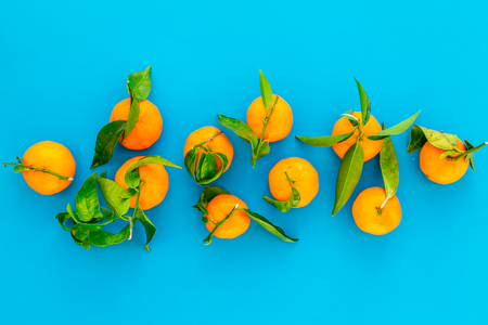 Winter fruits for New Year and Christmas. Tangerines on blue background top view