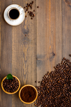 Coffee background with beans and cup of Americano wooden table flat lay space for text