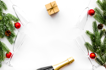 Spruce, champagne bottle, gift and glasses for Christmas celebration on white background top view mockup