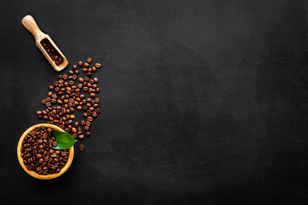 Coffee concept. Roasted beans, ground coffee on black background top view copy space. 版權商用圖片