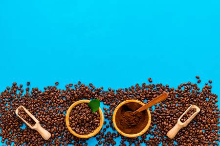 Coffee concept. Roasted beans, ground coffee on blue background top view copy space. Stock Photo