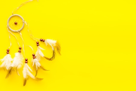 Dream catcher on yellow background top view. 스톡 콘텐츠