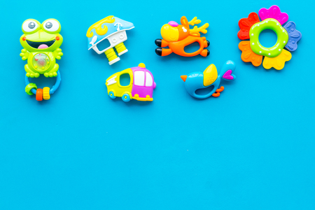 Handmade toys for newborn baby. Rattle. Blue background top view mockup. Stock Photo - 115048718