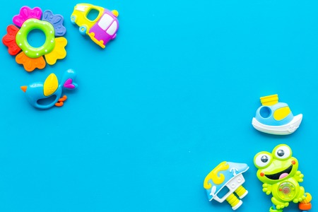 Craft toys for kids. Developing rattle for the smallest. Blue desk background top view mock up