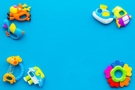 Craft toys for kids. Developing rattle for the smallest. Blue desk background top view mock up Stock Photo - 115048723