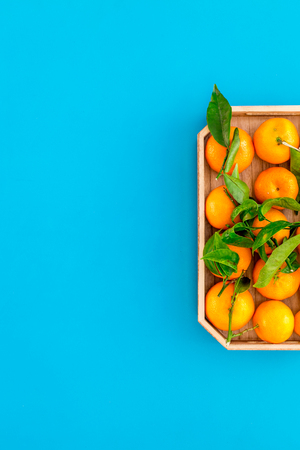 Pile of tangerines for New Year and Christmas celebration on blue table background top view mock up Stock Photo