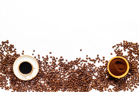 coffee background with beans and cup of americano white table flat lay space for text Imagens