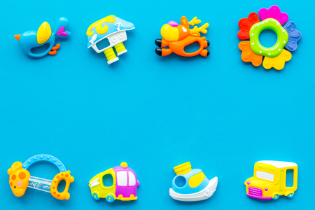 Craft toys for kids. Developing rattle for the smallest. Blue background top view mock up Stock Photo - 115206205