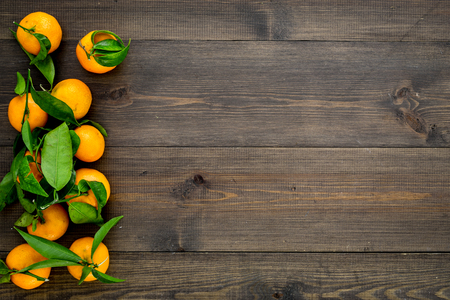 New Year and Christmas Eve with mandarins. Citrus winter fruits on wooden background top view space for text