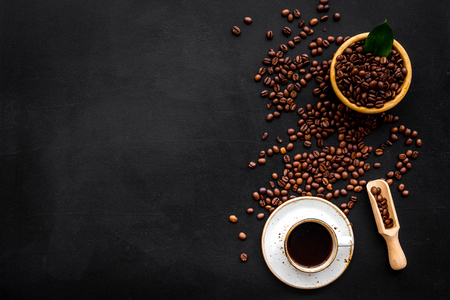 Coffee background with beans and cup of Americano black table flat lay space for text Imagens