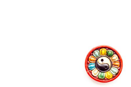 Buddhist symbol. Yin Yang symbol on white background top view.
