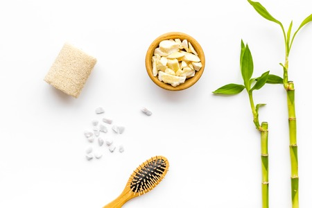 Asian spa background. Bamboo branch, spa cosmetics on white background top view Stok Fotoğraf