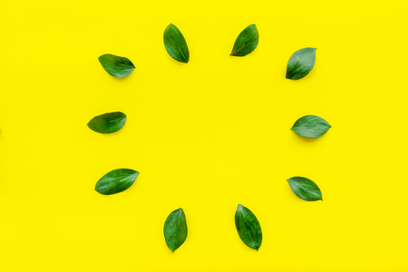 Mockup with leaves. Yellow background top view copy space Stock Photo