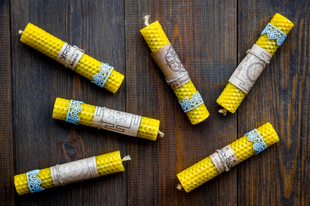 Buddhism. Candles with Yantras and mantras in Sanskrit on dark wooden background top view. Stock Photo