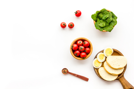 Healthy breakfast. Toasts with vegetables rocket and cherry tomatoes on white background top view copy space