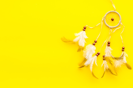 Asian attributes. Dream catcher on yellow background top view copy space Reklamní fotografie