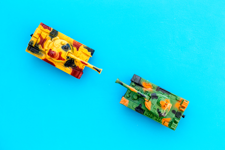 War concept. Tanks toy on blue background top view. Stock Photo - 115844611